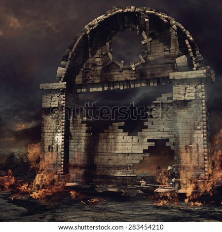 Old ruined city gate on fire - stock photo