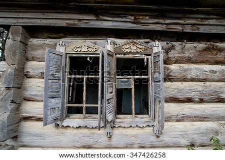 Old ruined house on the roadside  - stock photo