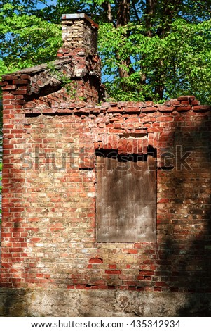 Old ruined of red brick house. - stock photo