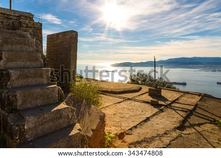 Old ruins on the top of the rock in Gibraltar with the stunning view on the channel and ships. - stock photo