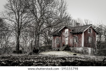 Old run down, ramshackle farm house in muted tones - stock photo