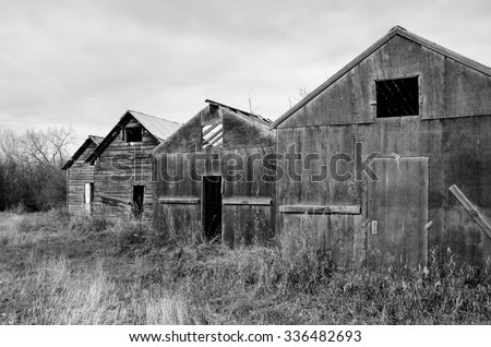 Old Rundown Rustic Farm Sheds Side By In Black White