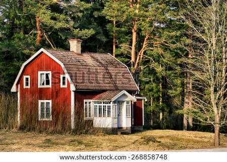 old rural farm, cottage house, trees and forest, 17th century Sweden - stock photo