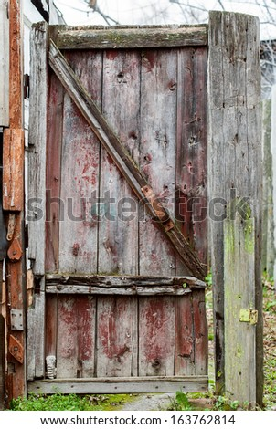 Old Rural Gate with shabby paint, outdoor