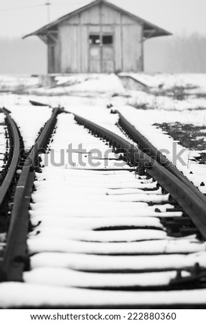 Old, rural railroads and railway station in winter time - stock photo
