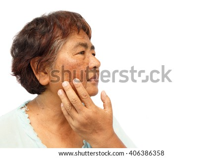 old rural woman with blemish , acne , mole and wrinkle on her face ( isolated background and blank area at right side ) ( anti-aging concept ) - stock photo