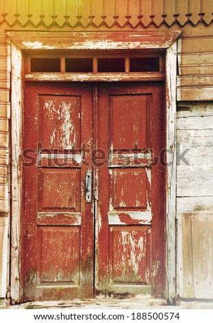 old rural wooden village door in the countryside