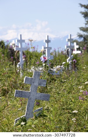 Old Russian Orthodox Church and cemetery in Ninilchik, Alaska - stock photo