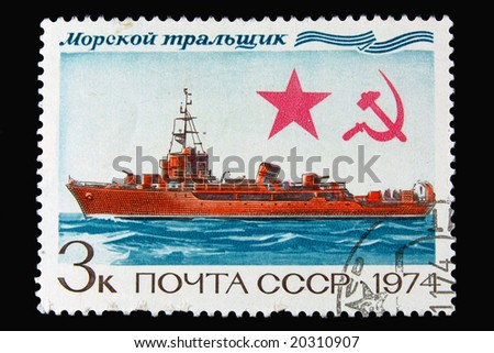 Old  Russian postage stamp with ship on black background - stock photo