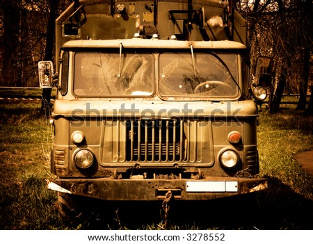 Old russian truck. Crazy burning colors. - stock photo