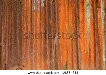 Old rusted corrugated metal wall - stock photo