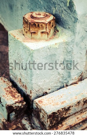 Old rusted industrial fragment, nuts and bolt, selective focus, shallow DOF, vintage toned photo with old style filter effect - stock photo