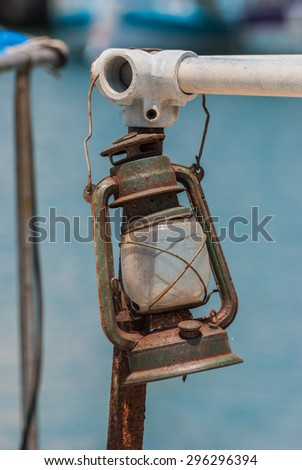 Old rusted lamp on a fishing boat. Close-up - stock photo