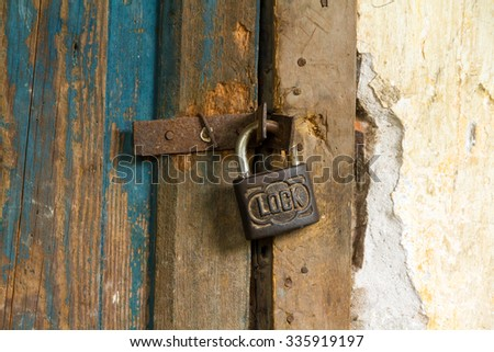 old rusted lock on a door