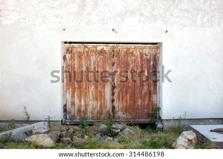 Old rusted metal door of a warehouse