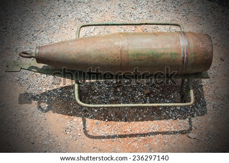 Old rusted World War II cannon shell - stock photo