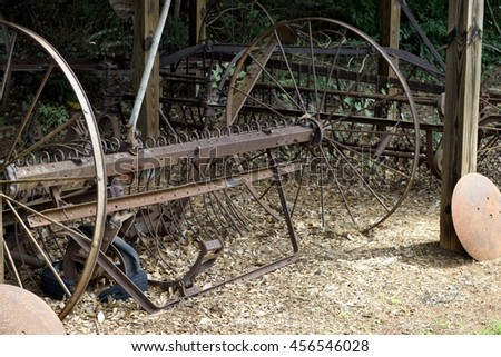 Old rustic farm equipment background - stock photo