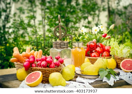 Old rustic hand blender and fruits and vegetables on table