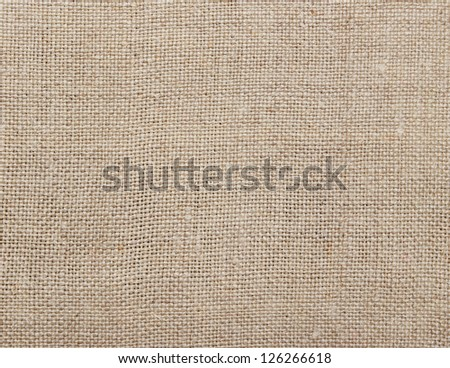 Old rustic homespun cloth as background - stock photo
