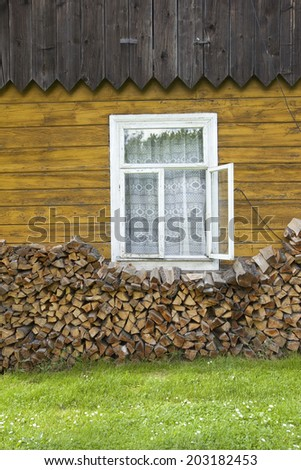 old rustic house with firewood