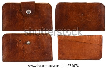 Old, rustic, leather brown wallet or set of blank labels isolated on white