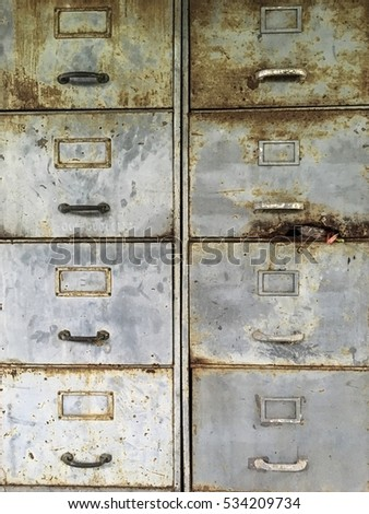 old rustic pull drawer steel filing cabinet  front face