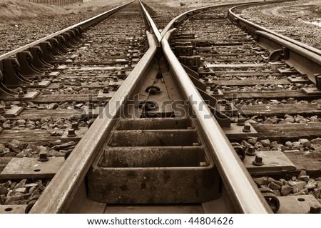 Old Rustic Railroad Track splitting lanes - stock photo