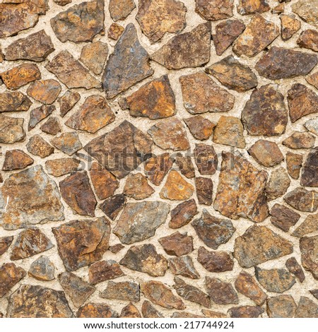 Old rustic rocks stone wall - stock photo