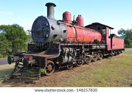 old rusting steam locomotive train wreck on tracks yesteryear transportation bygone era, australia - stock photo