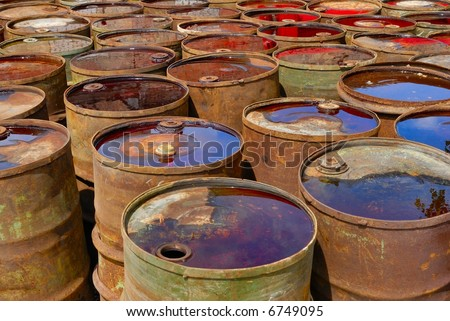 Old rusting tanks and barrels - stock photo