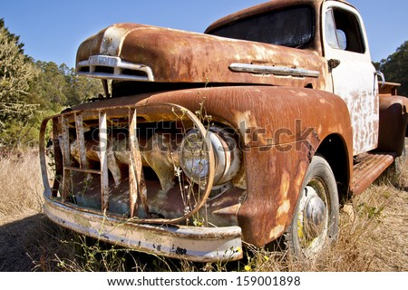 Old Rusty Abandoned Truck - stock photo