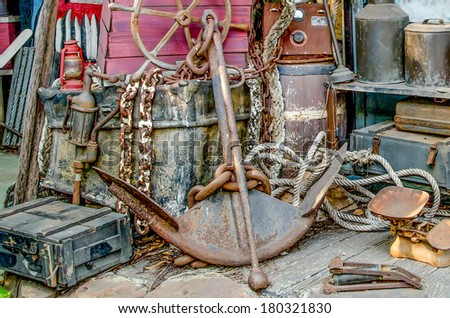 Old rusty anchor - stock photo