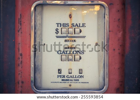 old rusty and vintage gasoline pump - stock photo