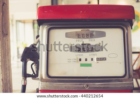 old rusty and vintage gasoline pump made with vintage filter. - stock photo