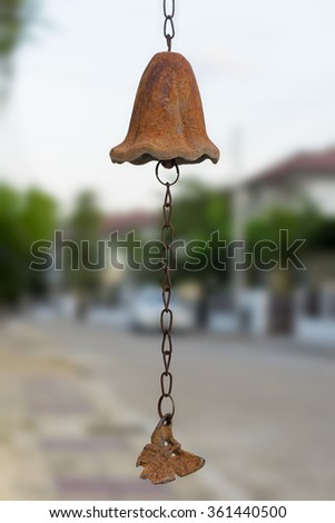 Old rusty bell with chain - stock photo