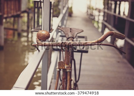 Old rusty bicycle. in the vintage tone - stock photo