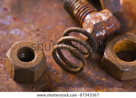 Old rusty bolts and steel nuts. Selective focus