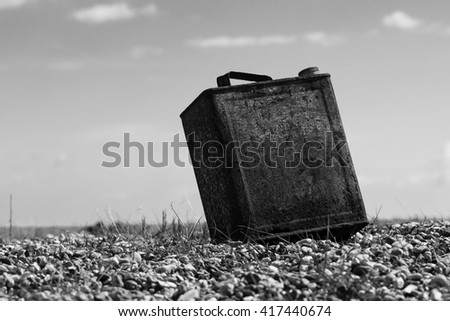 old rusty can - stock photo