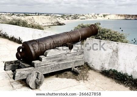 Old Rusty Cannon Guarding the Portuguese Fortress Sagres, Vintage Style Toned Picture - stock photo