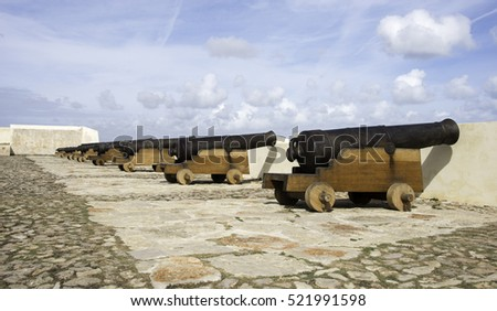 old rusty cannons on the castle walls at Sagres Portugal