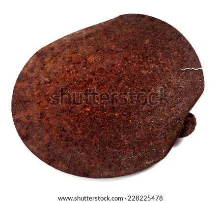 Old rusty cap of tincan isolated on white background - stock photo