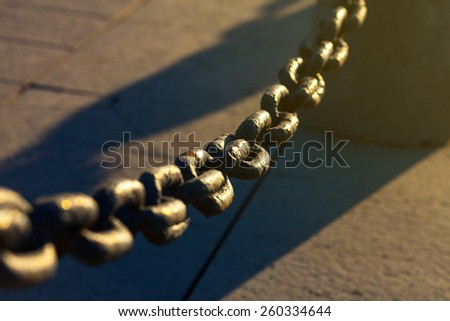 Old Rusty Chain Fence On The Street Under Sunshine. Urban Scene