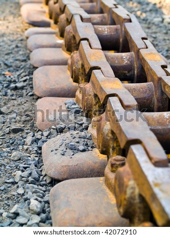 Old Rusty Continuous Tracks on Gravelly Ground