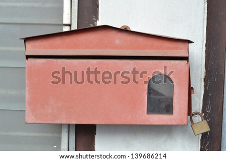 old rusty dirty broken mailbox - stock photo