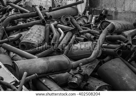 old  rusty exhaust pipe - stock photo