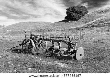 Old Rusty Farmers Tiller in Empty Field, Mountain, Sky, Black and White