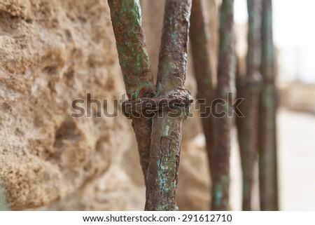 Old rusty fence blue iron bars abstract macro - stock photo