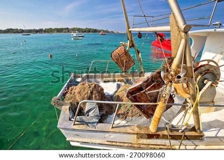 Old rusty fishing trawler in harbor view - stock photo