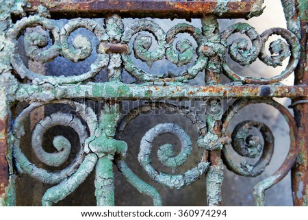 Old rusty forged fence, close up - stock photo
