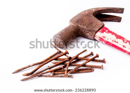 old rusty hammer and rusty nails on white background. - stock photo